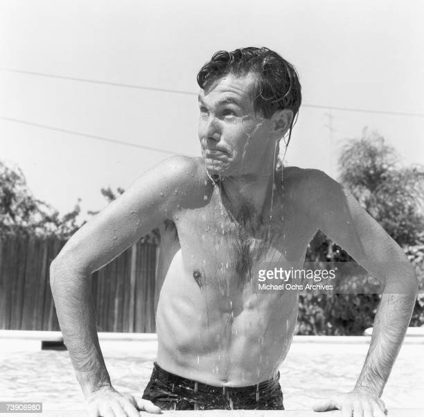 Johnny Carson host of The Johnny Carson Show on CBS plays in his pool at home on July 5 1956 in Los Angeles California