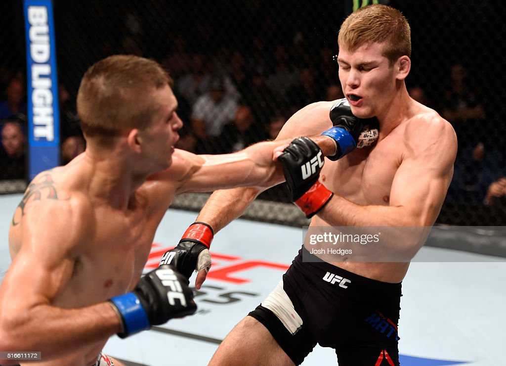 Johnny Case of the United States punches Jake Matthews of Australia in their lightweight bout during the UFC Fight Night event at the Brisbane Entertainment Centre on March 20, 2016 in Brisbane, Australia.