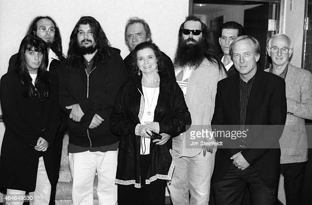 Johnny Cash and June Carter Cash pose with Rick Rubin Lou Robin and others backstage at the Greek Theatre in Los Angeles California on June 14 1997