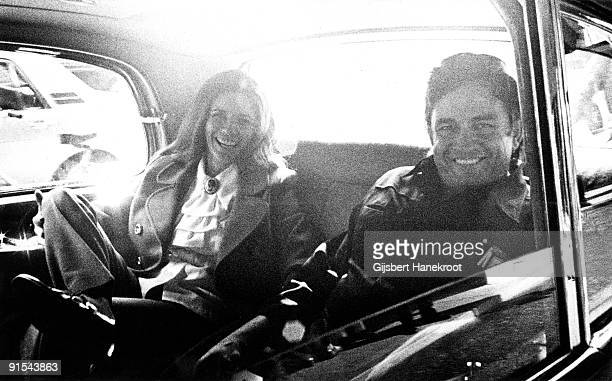 Johnny Cash and June Carter posed together in the back seat of their limousine in Amsterdam Holland in 1972