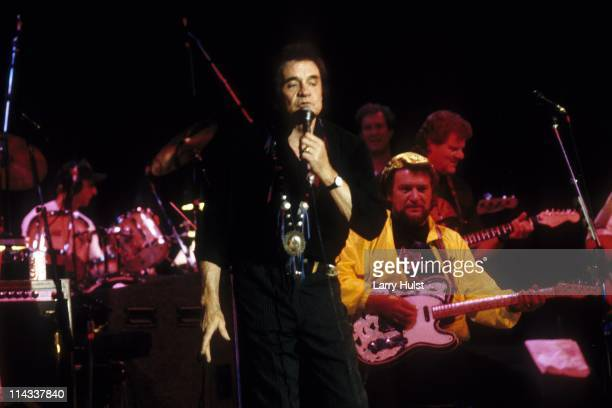 Johnny Cash and Waylon Jennings performing with 'The Highwaymen' at Arco Arena Sacramento California on January 1 1987