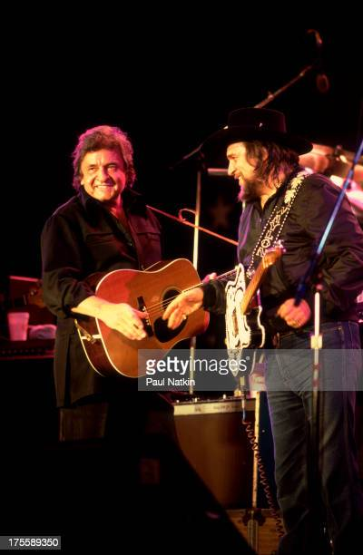 Johnny Cash with Waylon Jennings at the first Farm Aid concert held at Memorial Stadium Champaign Illinois September 25 1985