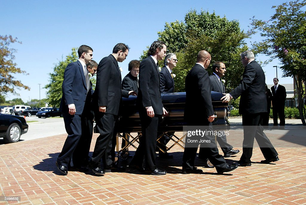 Johnny Cash's casket is carried at the funeral for country music legend Johnny Cash at the Hendersonville First Baptist Church September 15, 2003 in Hendersonville, Tennessee.