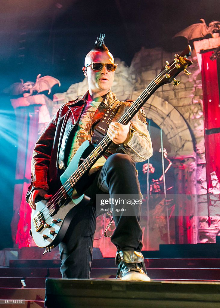 Johnny Christ of Avenged Sevenfold performs during the Hail to the King Tour at Joe Louis Arena on October 13, 2013 in Detroit, Michigan.