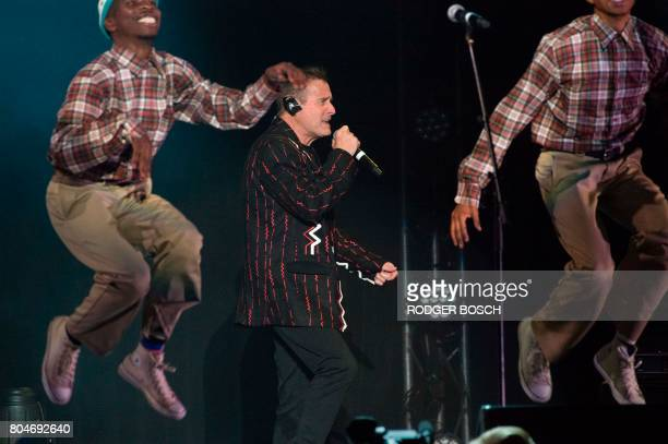 Johnny Clegg performs with backing dancers at Grandwest Arena on June 30 2017 in Cape Town on the first live gig of his final world tour after which...