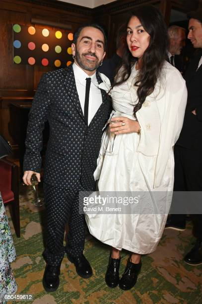 Johnny Coca and Simone Rocha attend a combined celebratory VIP dinner marking The Ivy's centenary year and 150 years of Harper's Bazaar sponsored by...