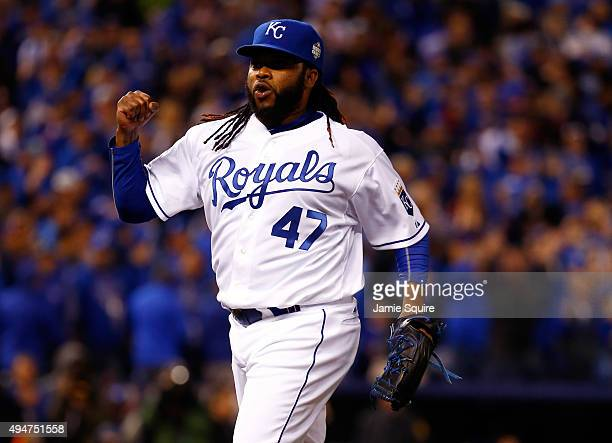 Johnny Cueto celebrates after Alcides Escobar of the Kansas City Royals fields a ground ball hit by Juan Lagares of the New York Mets in the eighth...