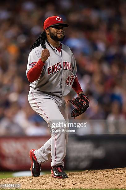 Johnny Cueto of the Cincinnati Reds celebrates striking out Charlie Blackmon of the Colorado Rockies for the last out of the eighth inning during a...