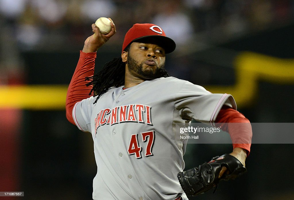 <a gi-track='captionPersonalityLinkClicked' href=/galleries/search?phrase=Johnny+Cueto&family=editorial&specificpeople=4921735 ng-click='$event.stopPropagation()'>Johnny Cueto</a> #47 of the Cincinnati Reds delivers a pitch against the Arizona Diamondbacks at Chase Field on June 21, 2013 in Phoenix, Arizona.