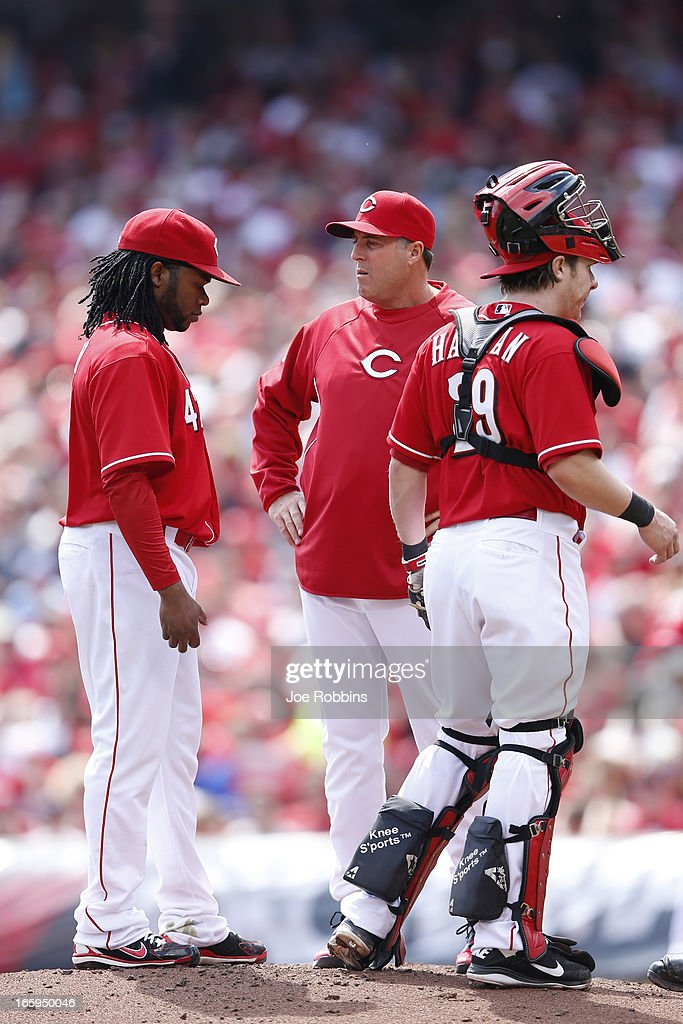 <a gi-track='captionPersonalityLinkClicked' href=/galleries/search?phrase=Johnny+Cueto&family=editorial&specificpeople=4921735 ng-click='$event.stopPropagation()'>Johnny Cueto</a> #47 of the Cincinnati Reds talks with pitching coach Bryan Price during a game against the Washington Nationals at Great American Ball Park on April 7, 2013 in Cincinnati, Ohio.