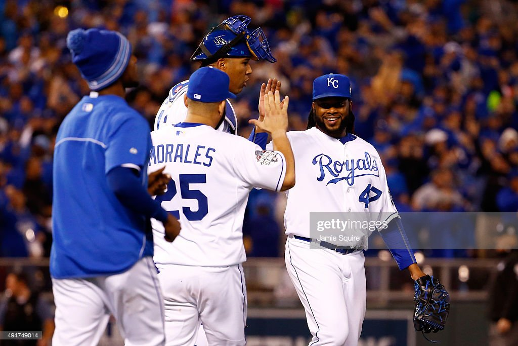 Johnny Cueto #47 of the Kansas City Royals celebrates with Salvador Perez #13 of the Kansas City Royals and Kendrys Morales #25 of the Kansas City Royals after defeating the New York Mets 7-1 in Game Two of the 2015 World Series at Kauffman Stadium on October 28, 2015 in Kansas City, Missouri.