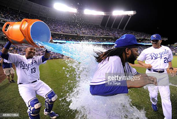 Johnny Cueto of the Kansas City Royals is doused with Gatorade by Salvador Perez after throwing a complete game shutout against the Detroit Tigers at...