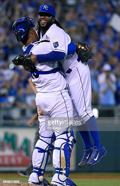 Johnny Cueto of the Kansas City Royals is hugged and picked up by Salvador Perez after throwing a complete game shutout against the Detroit Tigers at...