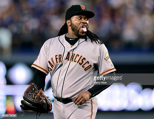 Johnny Cueto of the San Francisco Giants reacts to a hit from Corey Seager of the Los Angeles Dodgers during the first inning at Dodger Stadium on...