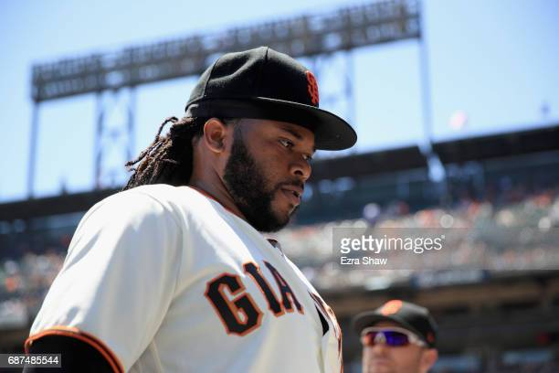 Johnny Cueto of the San Francisco Giants walks back into the dugout before their game against the Los Angeles Dodgers at ATT Park on May 17 2017 in...