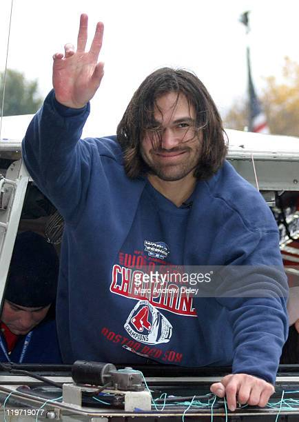 Johnny Damon of the Boston Red Sox during the Rolling Rally parade held in honor of the Red Sox World Series victory in Boston Massachusetts on...