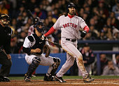 Johnny Damon of the Boston Red Sox hits a grandslam home run in the second inning against the New York Yankees during game seven of the American...