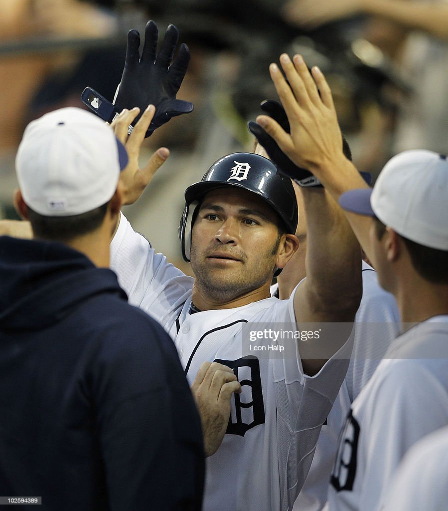 Johnny Damon #18 of the Detroit Tigers celebrates a seventh inning two run home run during the game against the Seattle Mariners on July 2, 2010 at Comerica Park in Detroit, Michigan.