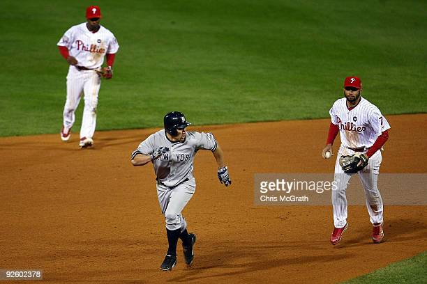 Johnny Damon of the New York Yankees advances to third base after he stole second base in the top of the ninth inning against Pedro Feliz and Jimmy...