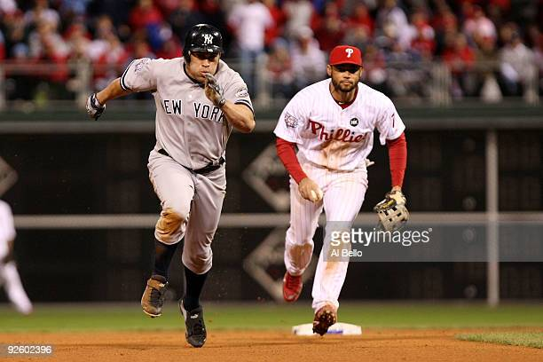 Johnny Damon of the New York Yankees advances to third base after he stole second base in the top of the ninth inning against Pedro Feliz of the...