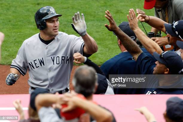 Johnny Damon of the New York Yankees celebrates with teammates after hitting a home run during the fifth inning off Jered Weaver of the Los Angeles...