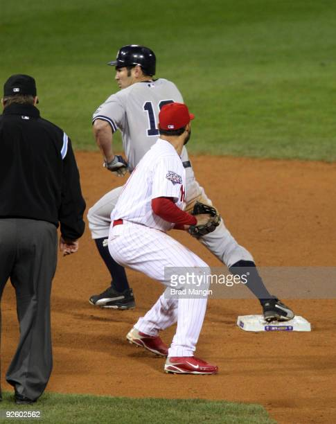 Johnny Damon of the New York Yankees goes on to steal third base in the top of the ninth inning of Game Four of the 2009 MLB World Series at Citizens...