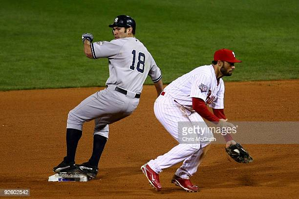 Johnny Damon of the New York Yankees steals second base in the top of the ninth inning against Pedro Feliz of the Philadelphia Phillies in Game Four...