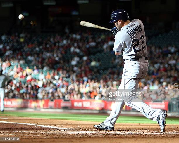 Johnny Damon of the Tampa Bay Rays singles to right field scoring Reid Brignac in the second inning at Minute Maid Park on June 25 2011 in Houston...