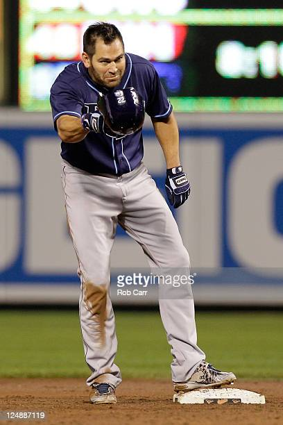 Johnny Damon of the Tampa Bay Rays tips his helmet after stealing second base for his 400th career stolen base against the Baltimore Orioles during...