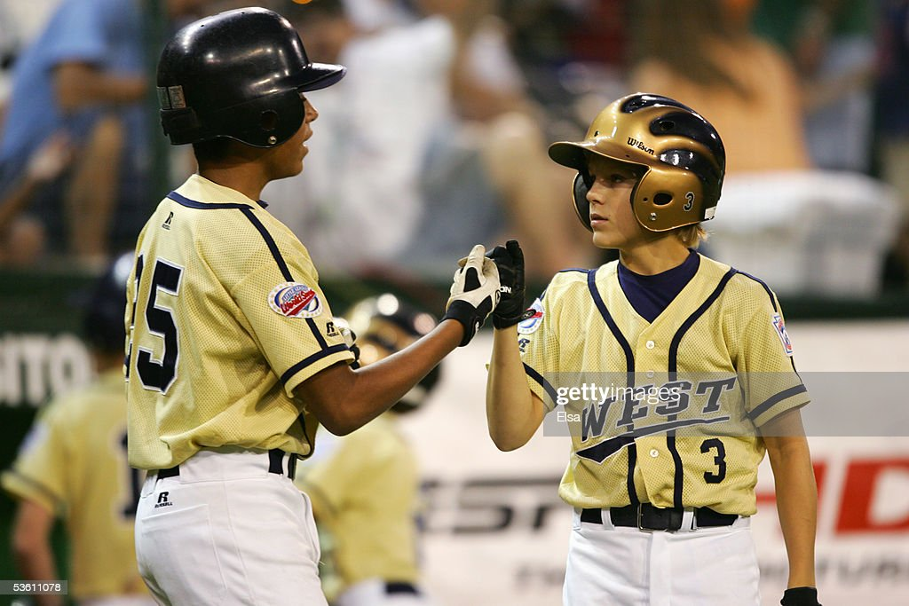 Johnny Dee #3 and Royce Copeland #25 of the West congratulate each other against the Southeast during the United States Semifinal of the Little League World Series on August 24, 2005 at Lamade Stadium in South Williamsport, Pennsylvania. The West team from Vista, California defeated the Southeast team from Maitland, Florida 6-2. (Photo by Elsa/Getty Images).