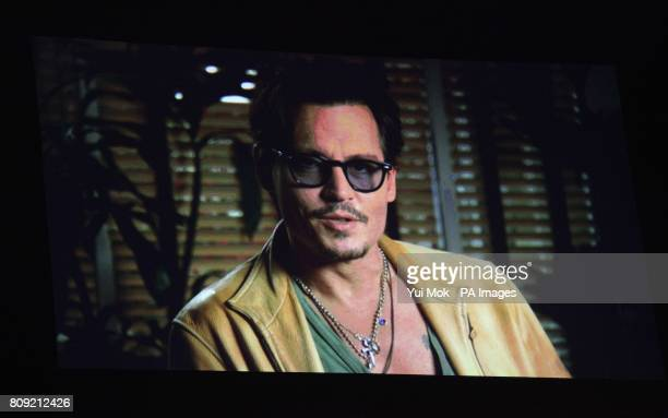 Johnny Depp accepts the screen icon award via video message during the 2011 National Movie Awards at Wembley Arena London