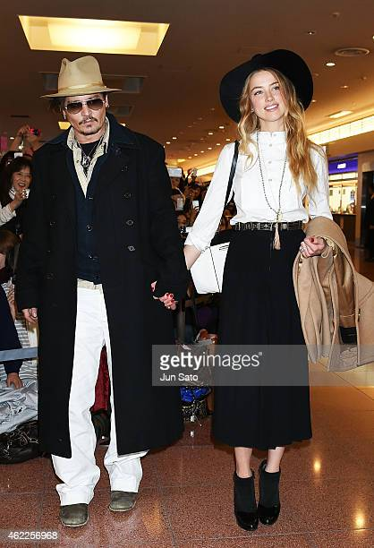 Johnny Depp and Amber Heard are seen upon arrival at Haneda Airport on January 26 2015 in Tokyo Japan