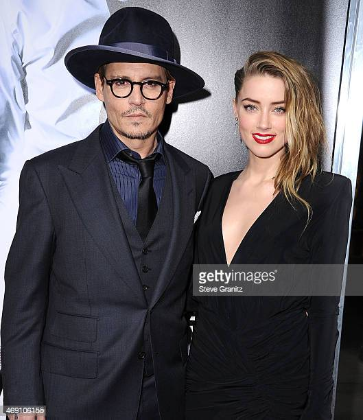 Johnny Depp and Amber Heard arrives at the '3 Days To Kill' at ArcLight Cinemas on February 12 2014 in Hollywood California