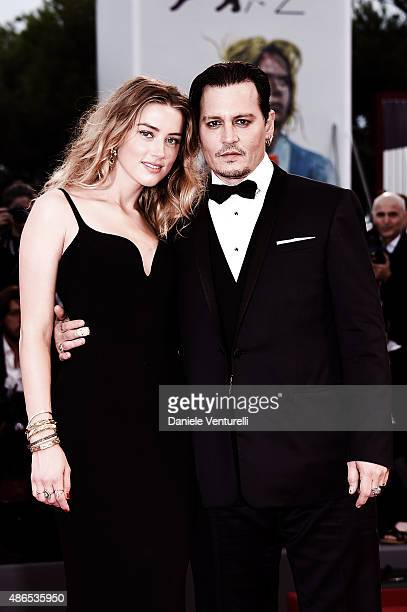 Johnny Depp and Amber Heard attend a premiere for 'Black Mass' during the 72nd Venice Film Festival on September 4 2015 in Venice Italy