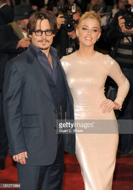 Johnny Depp and Amber Heard attend The UK Premiere of 'The Rum Diary' at on November 3 2011 in London England
