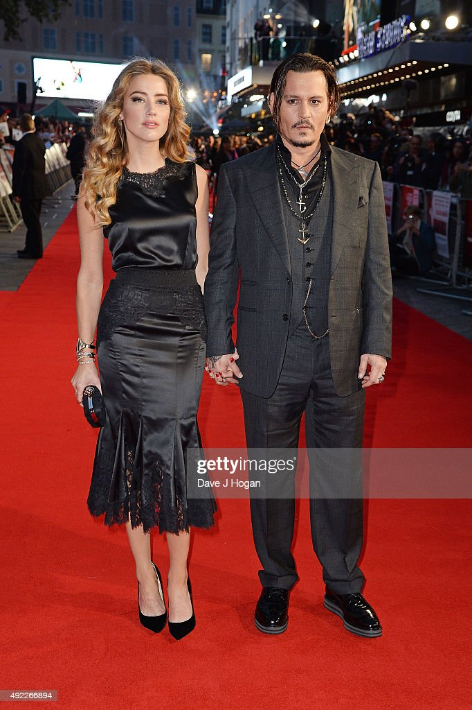 Johnny Depp (R) and Amber Heard attend the Virgin Atlantic Gala screening of 'Black Mass' during the BFI London Film Festival at Odeon Leicester Square on October 11, 2015 in London, England.