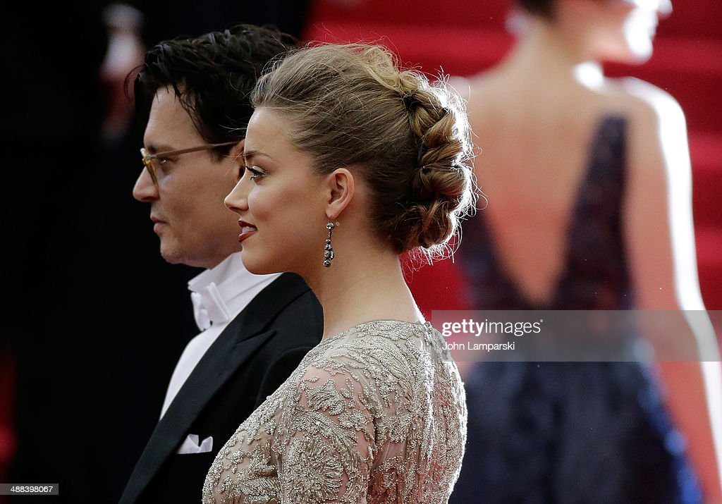 Johnny Depp and Amber Herd attend the 'Charles James: Beyond Fashion' Costume Institute Gala at the Metropolitan Museum of Art on May 5, 2014 in New York City.