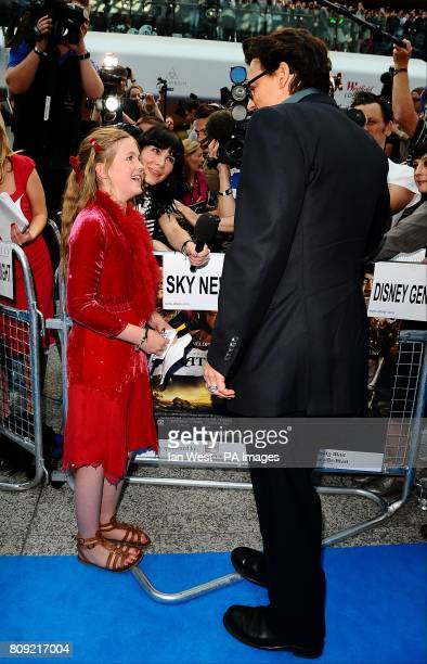 Johnny Depp and Beatrice Delap are interviewed as they arrive for the UK film premiere of Pirates of the Caribbean On Stranger Tides at the Vue...