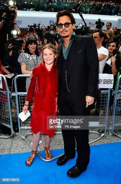 Johnny Depp and Beatrice Delap arriving for the UK film premiere of Pirates of the Caribbean On Stranger Tides at the Vue Westfield London