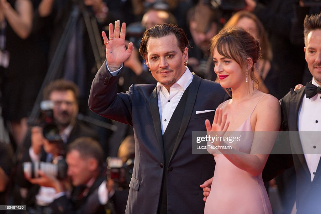 Johnny Depp and Dakota Johnson attend a premiere for 'Black Mass' during the 72nd Venice Film Festival at on September 4, 2015 in Venice, Italy.