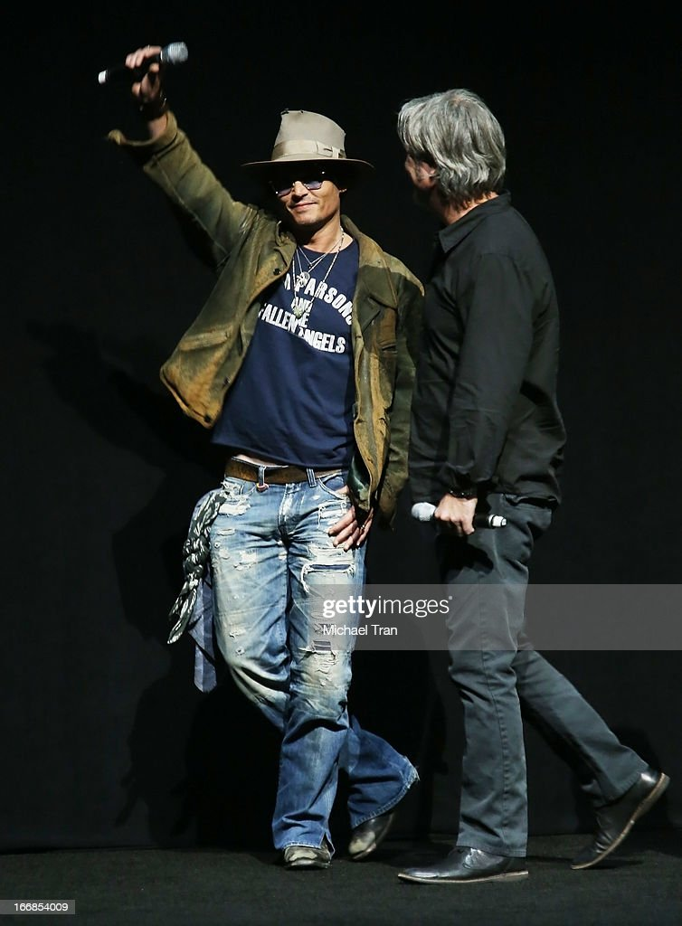<a gi-track='captionPersonalityLinkClicked' href=/galleries/search?phrase=Johnny+Depp&family=editorial&specificpeople=202150 ng-click='$event.stopPropagation()'>Johnny Depp</a> (L) and Gore Verbinski appear at a Walt Disney Studios Motion Pictures presentation to promote the upcoming film 'The Lone Ranger' held at The Colosseum at Caesars Palace during CinemaCon, the official convention of the National Association of Theatre Owners on April 17, 2013 in Las Vegas, Nevada.