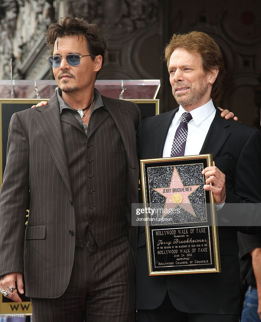 Johnny Depp (L) and Jerry Bruckheimer pose as Bruckheimer is honored on the Hollywood Walk Of Fame on June 24, 2013 in Hollywood, California.