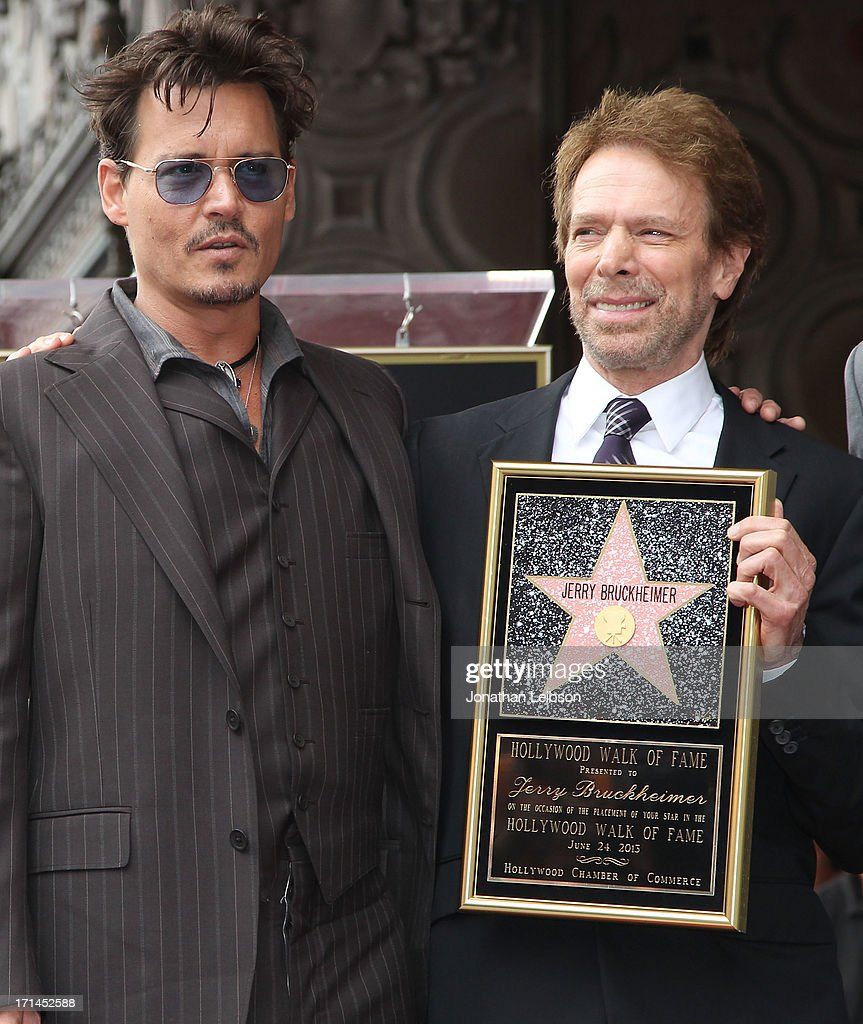 Johnny Depp and Jerry Bruckheimer pose as Bruckheimer is honored on the Hollywood Walk Of Fame on June 24, 2013 in Hollywood, California.