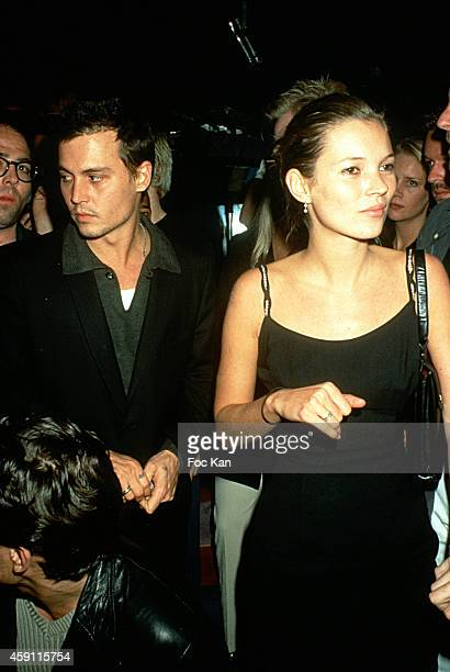 Johnny Depp and Kate Moss attend a fashion week Party at Les Bains Douches in the 1990s in Paris France