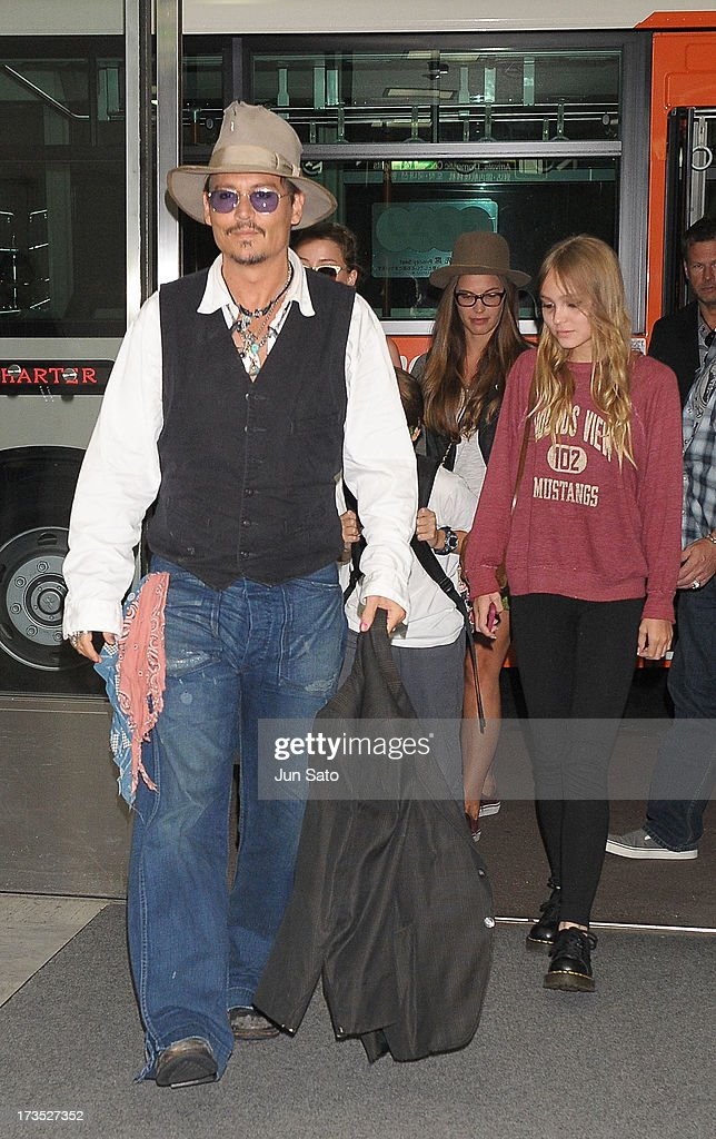 <a gi-track='captionPersonalityLinkClicked' href=/galleries/search?phrase=Johnny+Depp&family=editorial&specificpeople=202150 ng-click='$event.stopPropagation()'>Johnny Depp</a> and Lily Rose Melody Depp arrive at Narita International Airport on July 16, 2013 in Narita, Japan.
