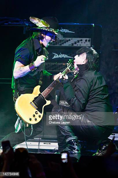 Johnny Depp and Marilyn Manson perform at the 4th annual Revolver Golden Gods awards at Club Nokia on April 11 2012 in Los Angeles California