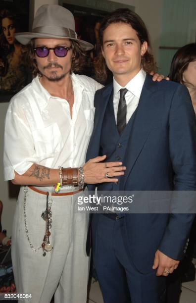 Johnny Depp and Orlando Bloom arriving for the European Premiere of Pirates of the Caribbean Dead Man's Chest at the Odeon Cinema in Leicester Square...