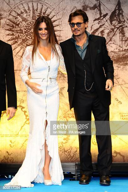 Johnny Depp and Penelope Cruz arriving for the UK film premiere of Pirates of the Caribbean On Stranger Tides at the Vue Westfield London