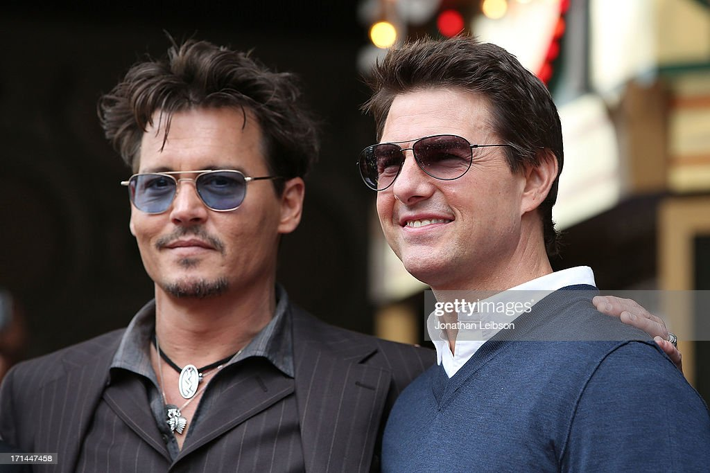 Johnny Depp and Tom Cruise pose as Jerry Bruckheimer is honored on the Hollywood Walk Of Fame on June 24, 2013 in Hollywood, California.