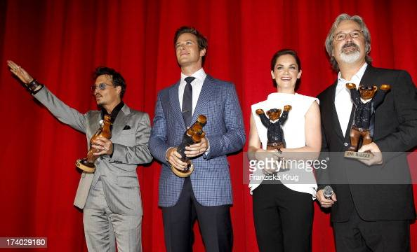 Johnny Depp Armie Hammer Ruth Wilson and Gore Verbinski attend the 'Lone Ranger' Berlin Premiere at Sony Centre on July 19 2013 in Berlin Germany